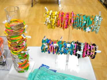 A beaucoup bunch of beaded bracelets.